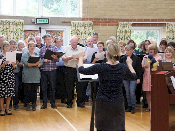 Taken by the Ely Standard Newspaper, Sing! Choirs and Sing'n'Swing perform together after an afternoon of learning new songs!  Conducted by Sing! Choirs MD Kathryn Rowland