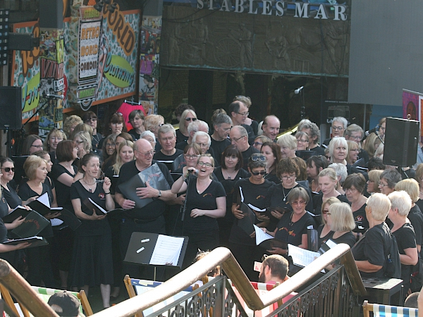 Sing! Choirs from Ely, Cambridge and Newmarket visit Camden Markets in London to perform on Saturday 8 July 2017 as part of the Voices Now Festival - Sing! Choirs MD Kathryn Rowland introducing the choir!